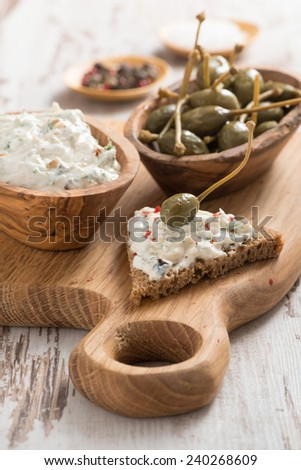 toast with cheese pate and capers, vertical - stock photo