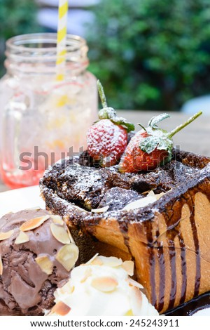 Toast with chocolate fudge and strawberry