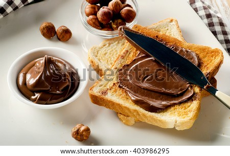 Toast with chocolate spread for a sweet breakfast. - stock photo