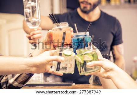 toast with cocktails glasses. concept about night life, alcohol, friendship, bartending, fun , and people - stock photo
