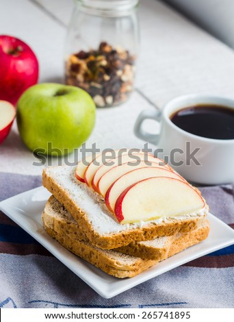 toast with curd cheese, apple, honey and dried fruits, coffee, healthy breakfast, white background - stock photo