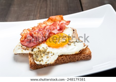 toast with fried eggs and bacon - stock photo
