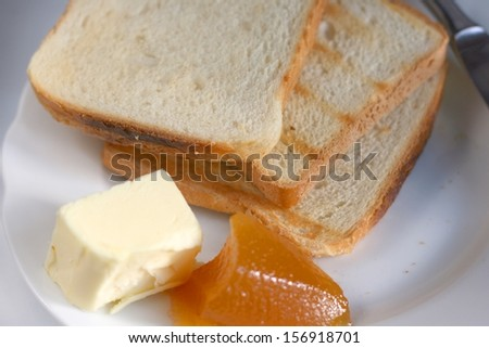 Toast with jam and butter, shallow DOF