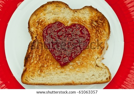 Toast with Jam in the shape of Heart - stock photo