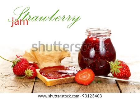 Toast with strawberry jam and fruits, rustic style with place for your text on the left - stock photo