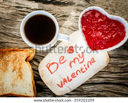 Toast with strawberry jam. Be My Valentine white message card with hand made hearts. Valentine's Day. - stock photo
