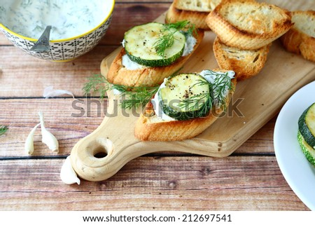 toast with zucchini and cheese, food closeup - stock photo
