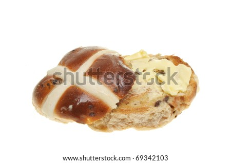Toasted and buttered hot cross bun isolated on white - stock photo