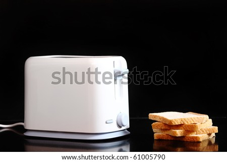 Toasted bread and toaster over dark marble