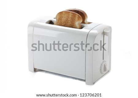 Toasted bread in a toaster isolated on white. - stock photo