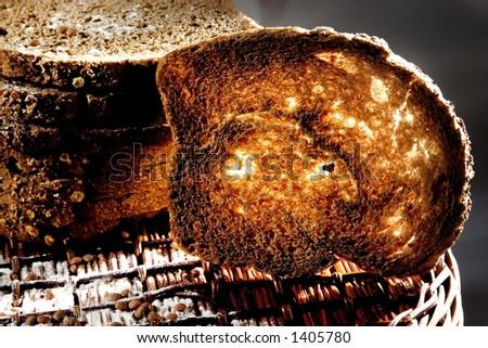 Toasted bread on basket, nice light. - stock photo