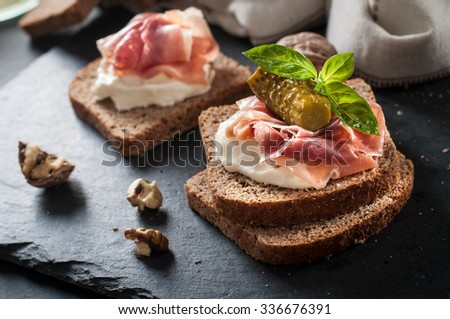 toasted bread slice with smoked meat and mayonnaise