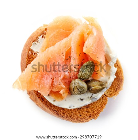 toasted bread slice with smoked salmon and capers isolated on white background, top view