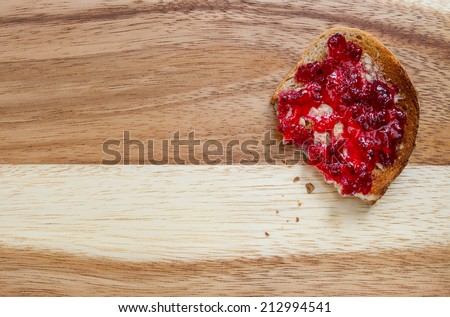 Toasted bread with butter and redcurrant jam Sharp and detailed shot with copy space on left - stock photo