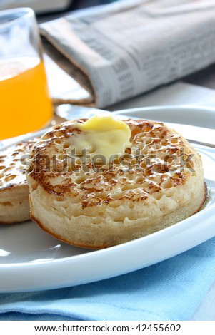 Toasted butter crumpets on a plate - stock photo