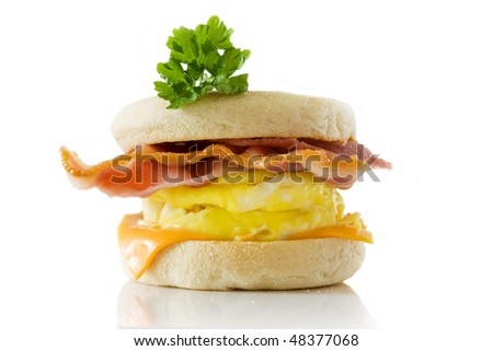 Toasted English bacon & egg muffin against a white background