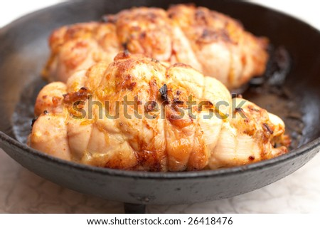 Toasted fried meat rolls on black frying pan - stock photo