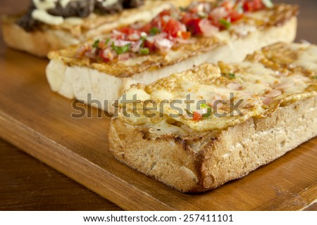 Toasted open faced omelette egg sandwich with melted mozzarella cheese close up - stock photo
