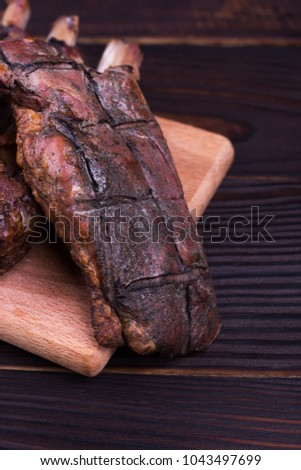 Toasted piece of meat on dock. Juicy cooked piece of meat