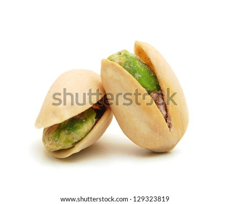 toasted pistachios on a white background - stock photo