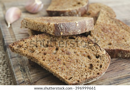 Toasted rye bread on a wooden board. Rustic style.