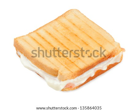 Toasted sandwich with ham and cheese on white background - stock photo