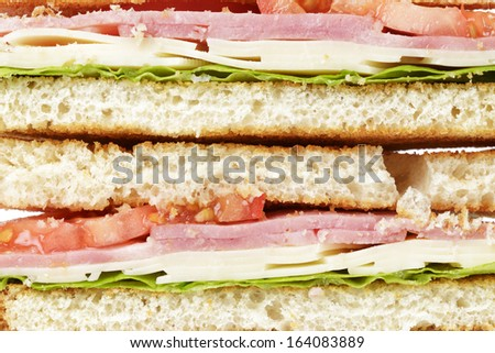 toasted sandwich with ham, cheese and vegetables, close up - stock photo