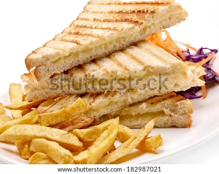 Toasted sandwiches with cheese and fried potatoes, close up