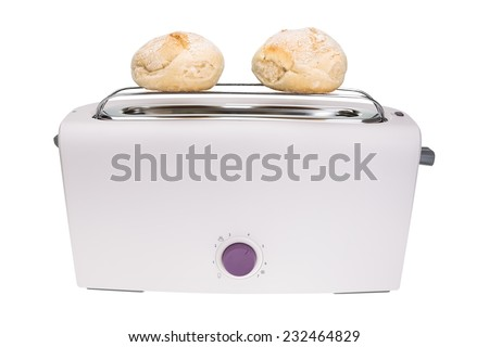 Toaster and fresh baked buns. For breakfast. - stock photo