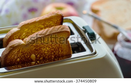 Toaster and two hot toasts ready to serve for the breakfast - stock photo