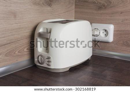 Toaster on the kitchen table. Kitchen appliances - stock photo
