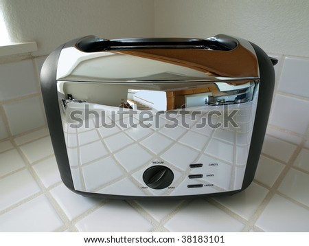 Toaster reflecting a bright, clean condo kitchen. - stock photo