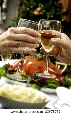 toasting over holiday dinner - stock photo