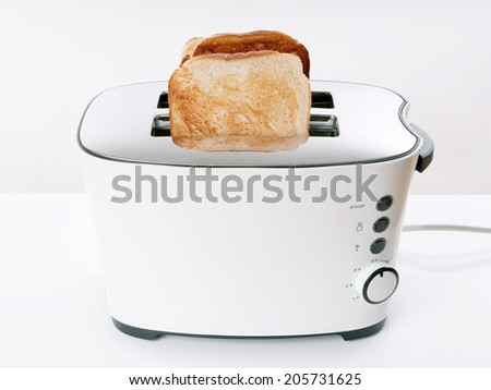 toasting sliced bread in toaster