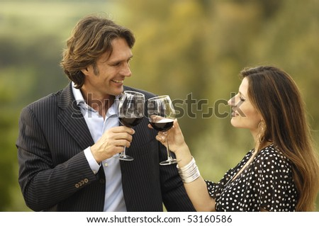 Toasting with glasses of wine - stock photo