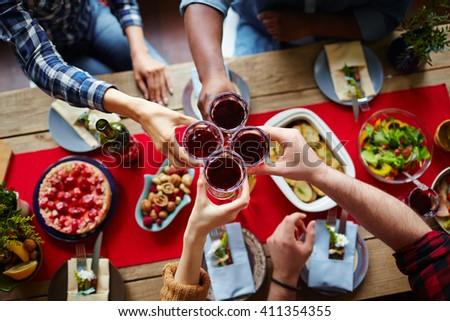 Toasting with homemade wine - stock photo