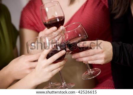 Toasting,  women drinking red wine - stock photo