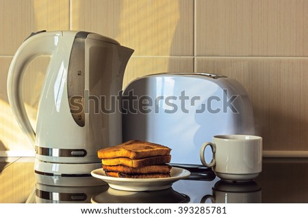 Toasts, kettle and toaster. - stock photo