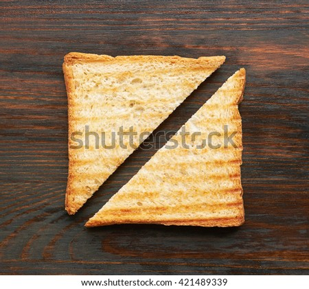 Toasts on wooden background, close-up - stock photo