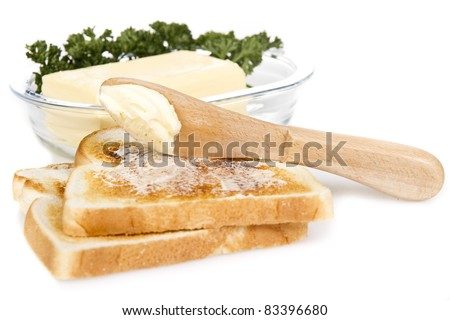 Toasts with butter and knife over white background - stock photo