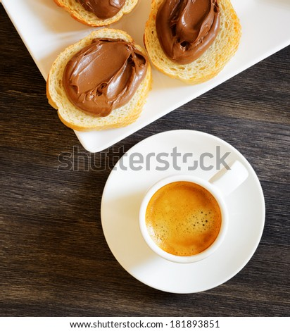 Toasts with chocolate spread  and espresso coffee. Morning breakfast concept. - stock photo