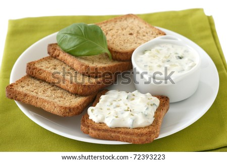 toasts with cucumber dip - stock photo