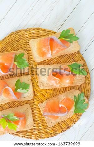 toasts with salmon - stock photo