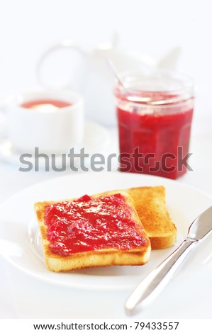Toasts with strawberry jam and fruit tea - stock photo