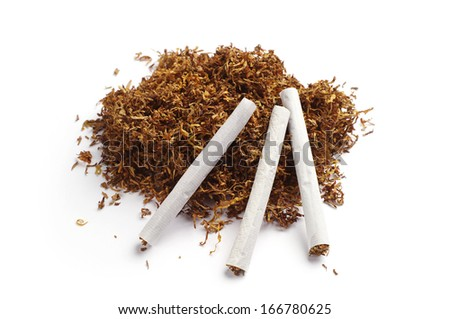 Tobacco and hand rolled cigarettes on white background - stock photo