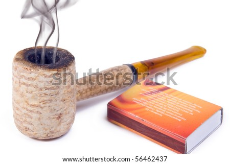 Tobacco pipe isolated on white background - stock photo