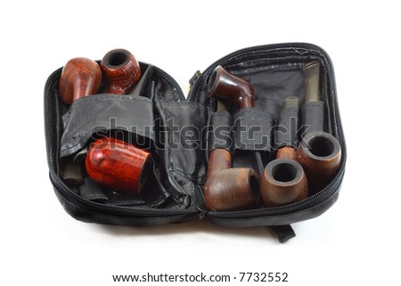 tobacco pipe set in a black leather bag isolated on white - stock photo