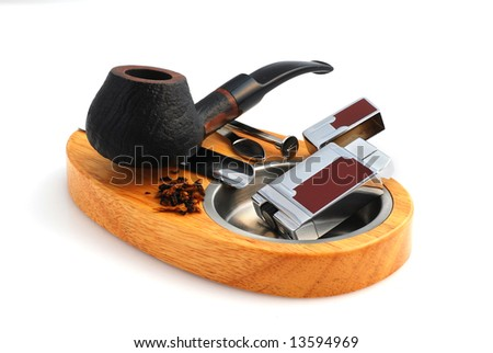 Tobacco-pipes and ashtray isolated in white
