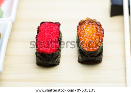 Tobiko and Ikura sushi on served table - stock photo