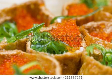 Tobiko Inari Sushi - stock photo
